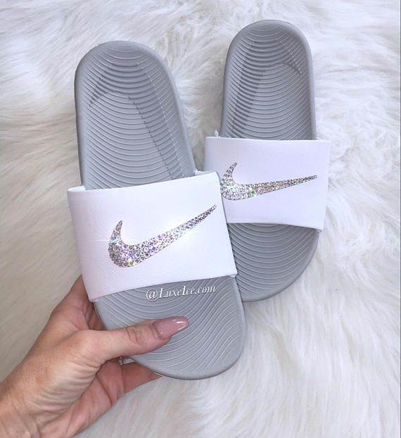 Nike kawa slide flips flops customized with rose gold swarovski crystals.  Selected style: white/metallic silver fit: true to size available in  multiple ...