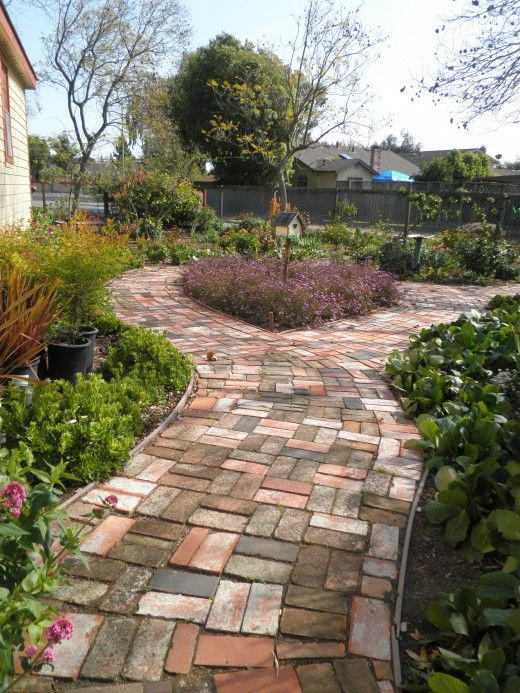 Landscaping ideas using bricks : Bricks lovely colors mixed together make a stunning path great use