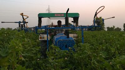 Farmer Gurmeet Singh Bhupal with his Invention in his Cotton Fields at Makkasar, Rajasthan, India