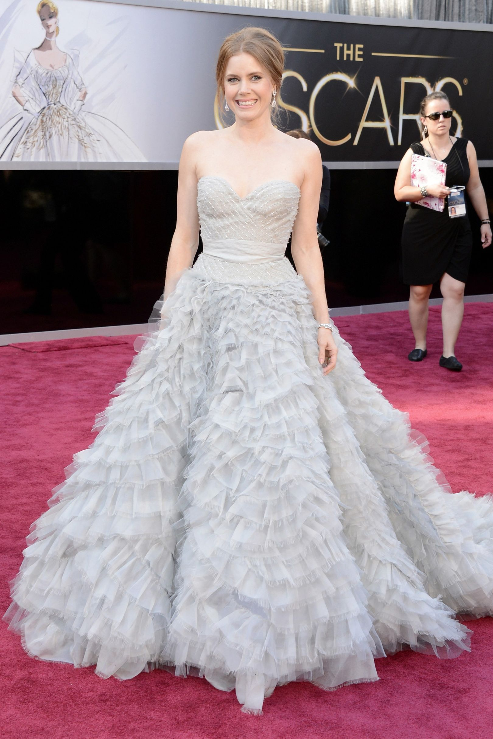 e0f17fba6517e Best Supporting Actress nominee Amy Adams in an Oscar De La Renta strapless  lavender gown with full ruffled skirt.