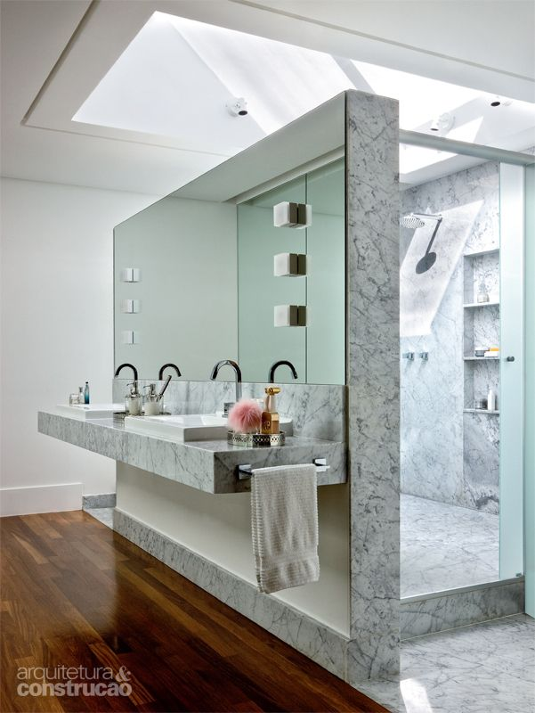 grey marble bathroom with hollywood lights on the vanity mirror
