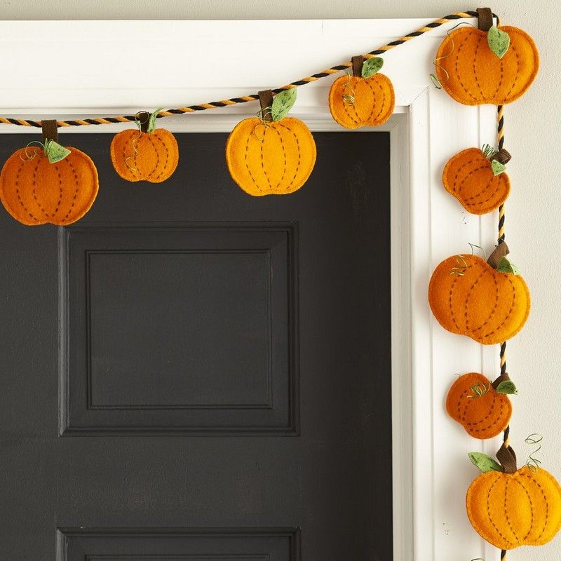 Pumpkin Patch Garland - Decorate for the harvest season with our playful pumpkin-themed Halloween garland, crafted of wool felt and strung on black-and-orange cord. Draped over a doorway, mantel or staircase, this whimsical garland brings seasonal cheer to indoor spaces.