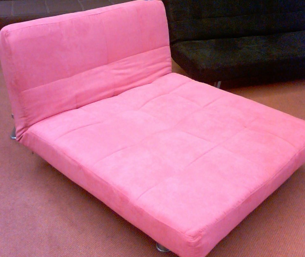 Outstanding Bright Pink Futon Folds Two Different Ways Cool Things I Andrewgaddart Wooden Chair Designs For Living Room Andrewgaddartcom