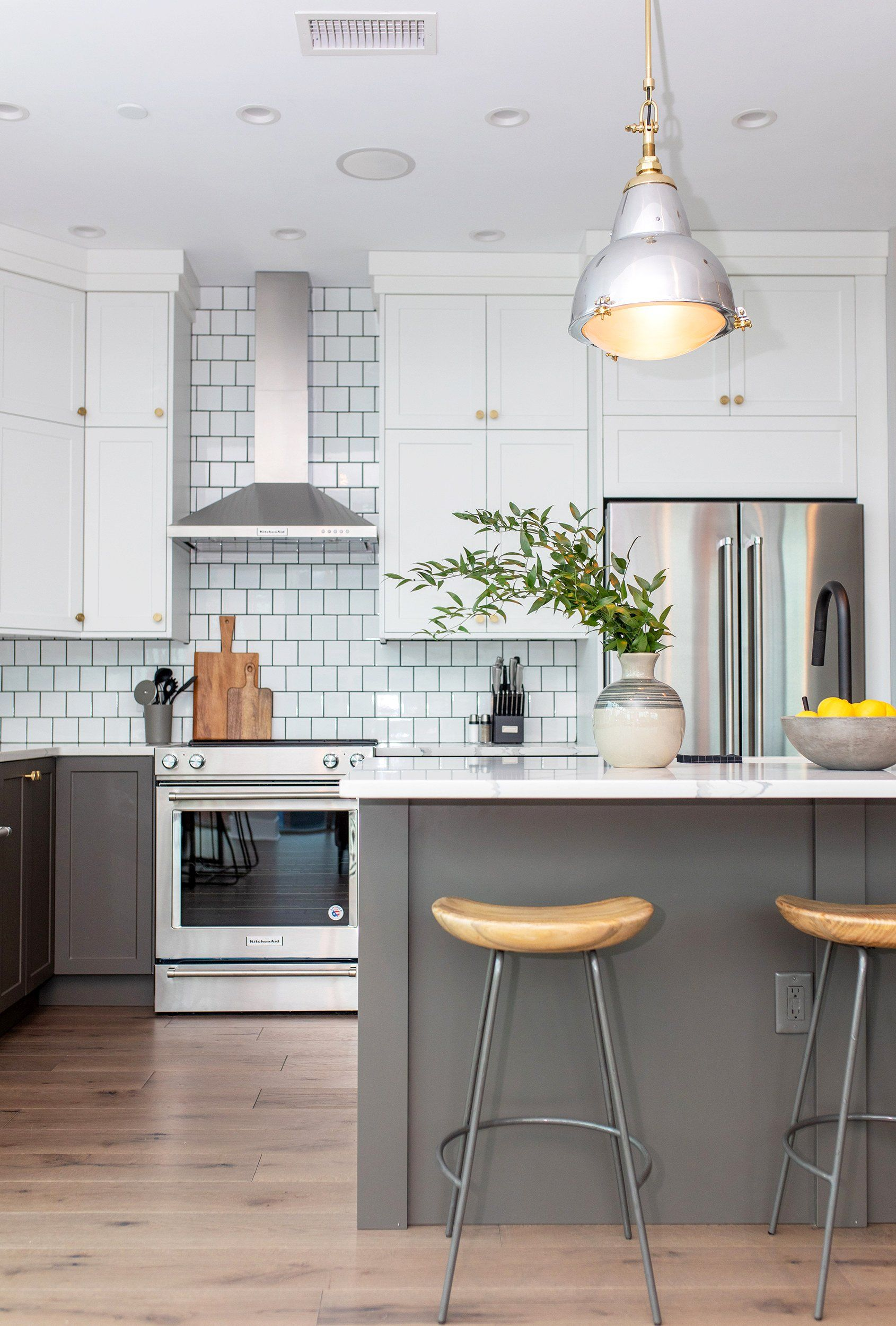 Modern Two Tone Kitchen In This Downtown Condo Two Tone Kitchen Kitchen Cabinets Kitchen Cabinets Pictures