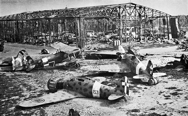 Wrecked Italian Fiat CR.42 and G.50 aircraft at Castel Benito airport, Tripoli, Libya, in 1943.