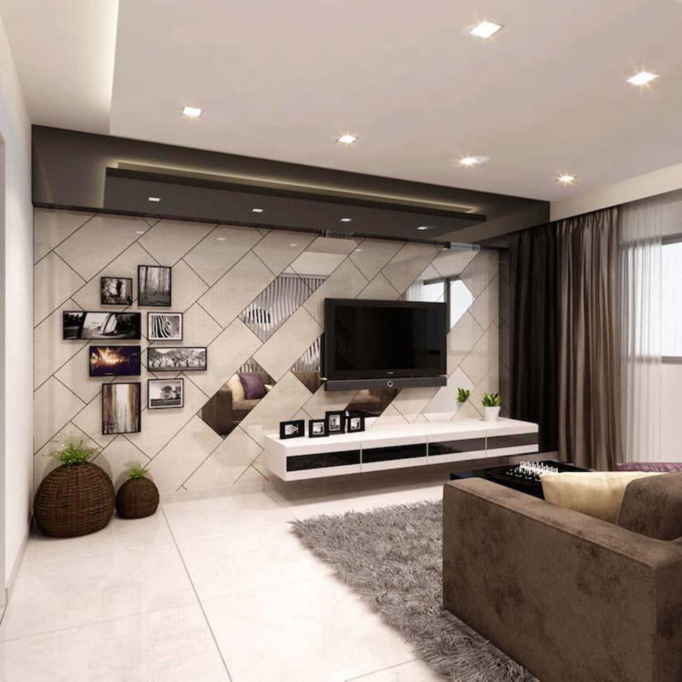 The Example Above Showed A Living Room, Put All Focus On The TV Unit With Striking  Designs. The Mirror Effect At The Wall And The Wall Hanging Create A ...