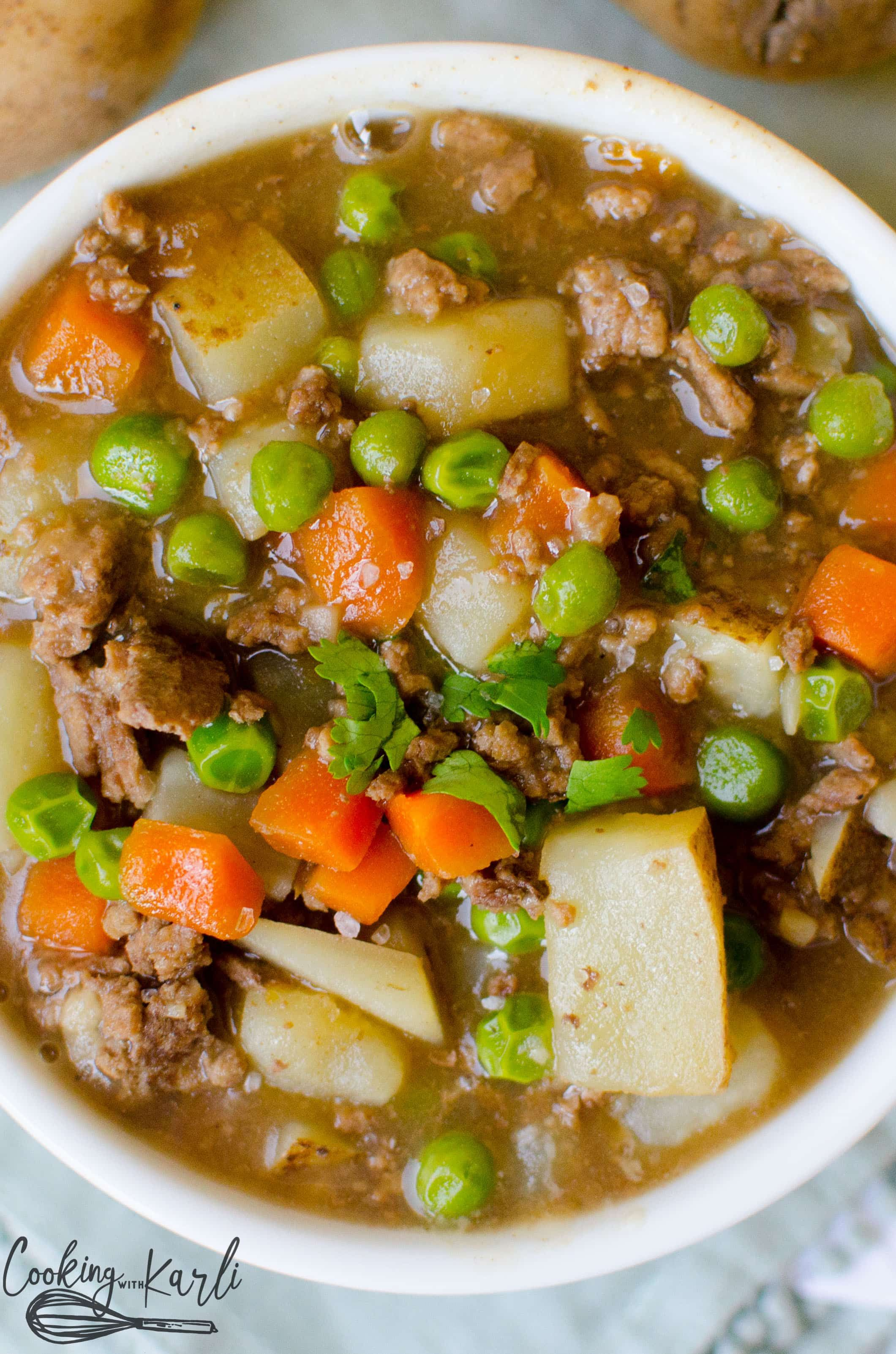 Instant Pot Ground Beef Stew Made With Potato Chunks Carrots Peas And Ground Beef Which Are Soup With Ground Beef Ground Beef Stews Instant Pot Soup Recipes