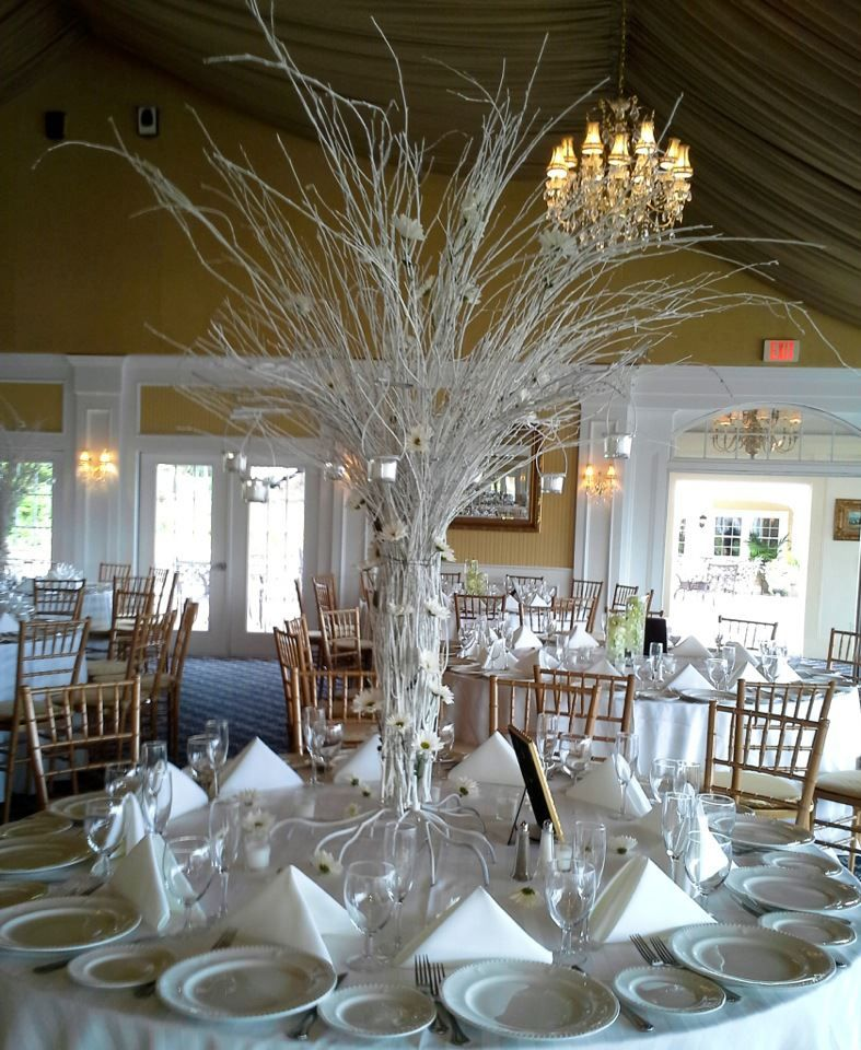Wedding Centerpiece Of White Birch Branches With Daisy Heads And Hanging Votive Cups Doristhefloristt Com Event Centerpiece Centerpieces Votive Cups