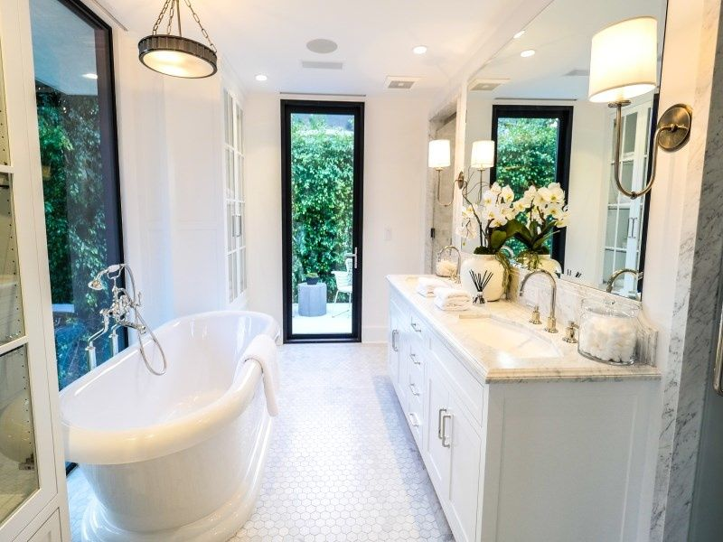 Traditional Full Bathroom with penny tile floors, Complex Marble, Double sink, Flat panel cabinets, Complex marble counters