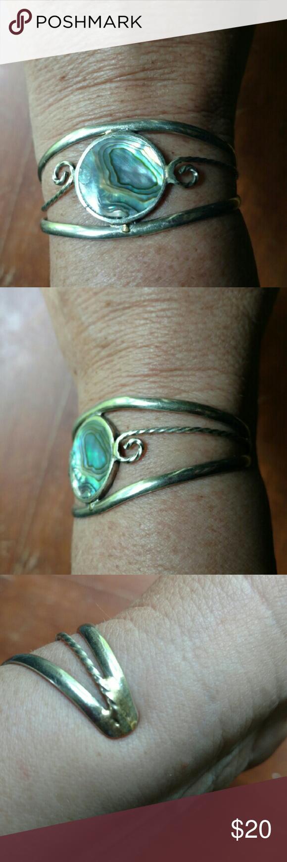 Round Abalone and Silver Bracelet Comfortably fits a size 7.25 size wrist, however, it can adjust a bit larger. Jewelry Bracelets