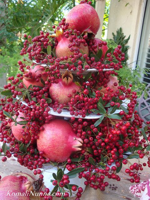 Pomegranates and berries from the garden make a stunning centerpiece.