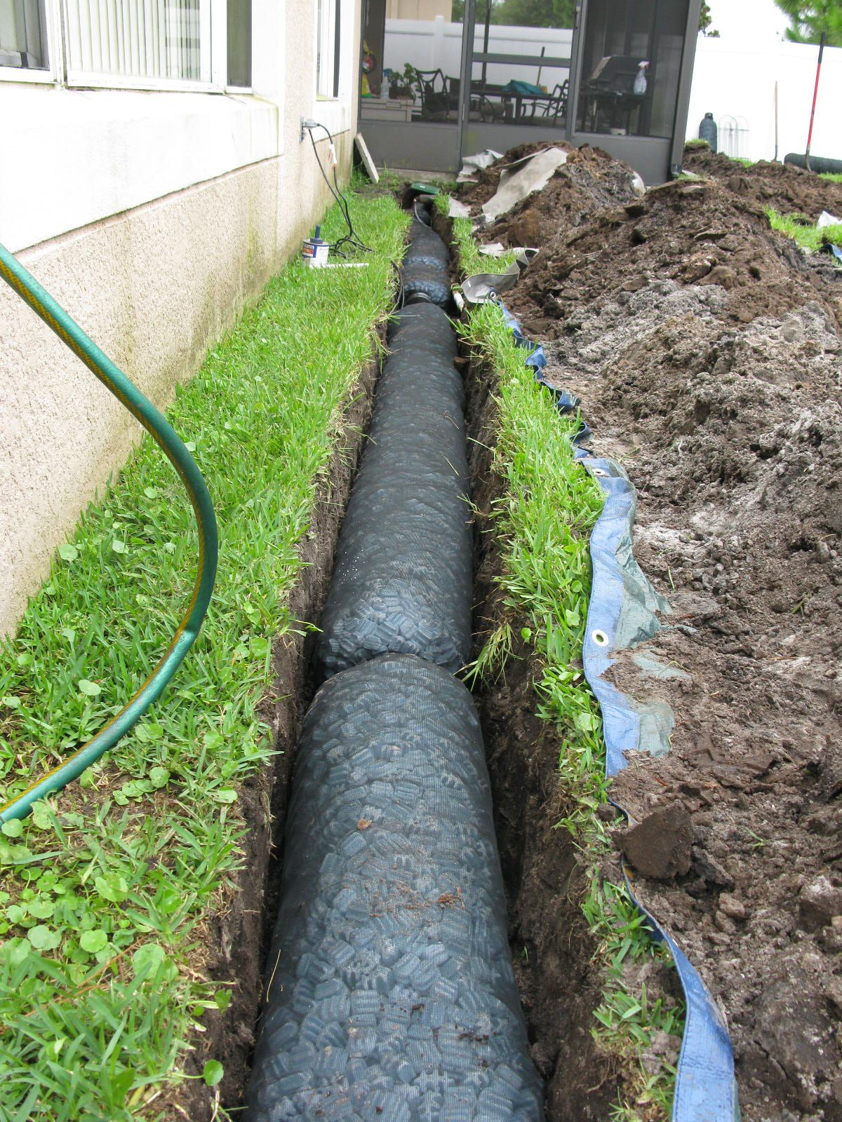 Nds ez drain pre constructed french drain installation for Drain pipe landscaping