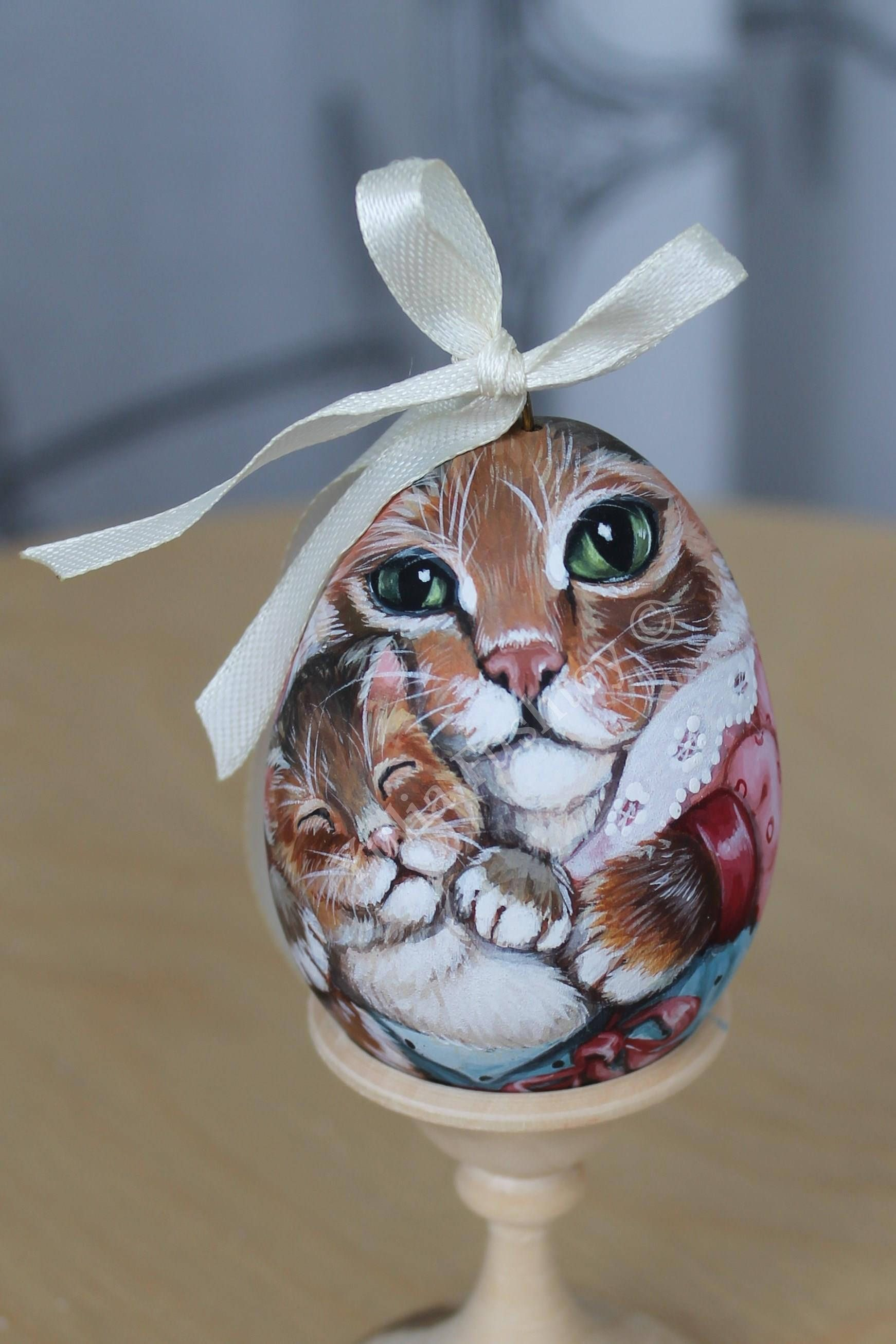 Souvenir, hand painted on wood. Cat with a kitten. Brings
