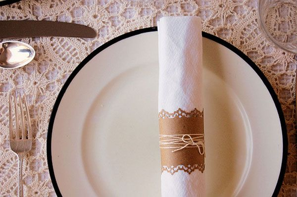 Really easy napkin ring....punched kraft paper and twine.