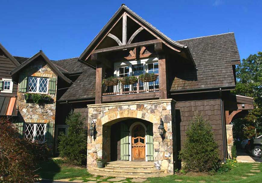 2-story stone & timber frame tower adds drama and function to side
