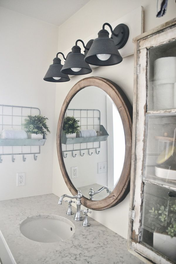 See how to make this super simple farmhouse bathroom vanity light fixture  on a budget. DIY Farmhouse Bathroom Vanity Light Fixture     Farmhouse