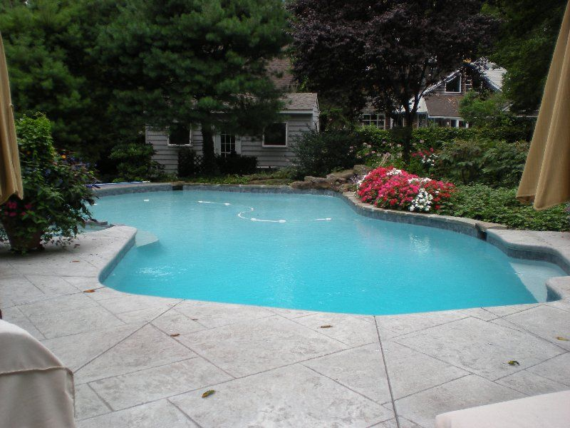 Cantilever stamped concrete pool deck | Backyard ...