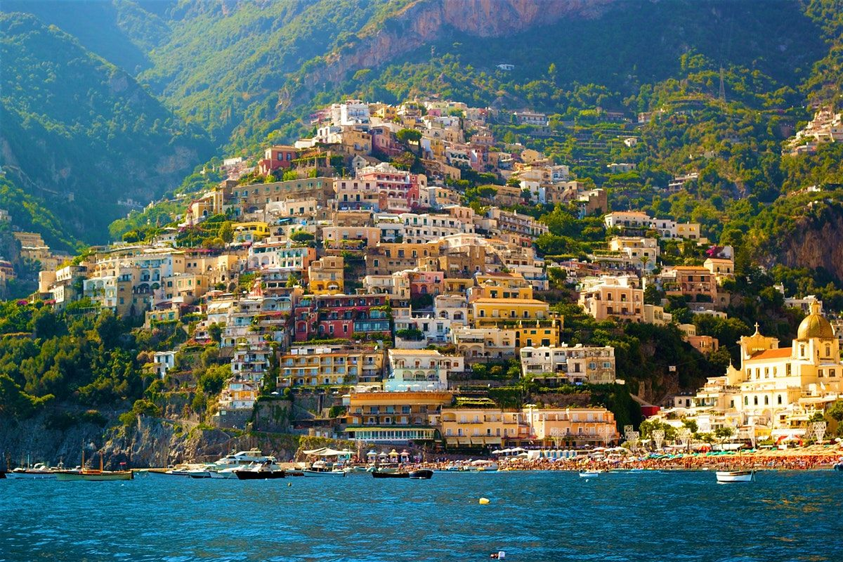 Positano Is The Amalfi Coast S Most Photogenic And Expensive Town With Vertiginous Houses Tumbling Down To The Sea In Visit Italy Amalfi Coast Italy Travel