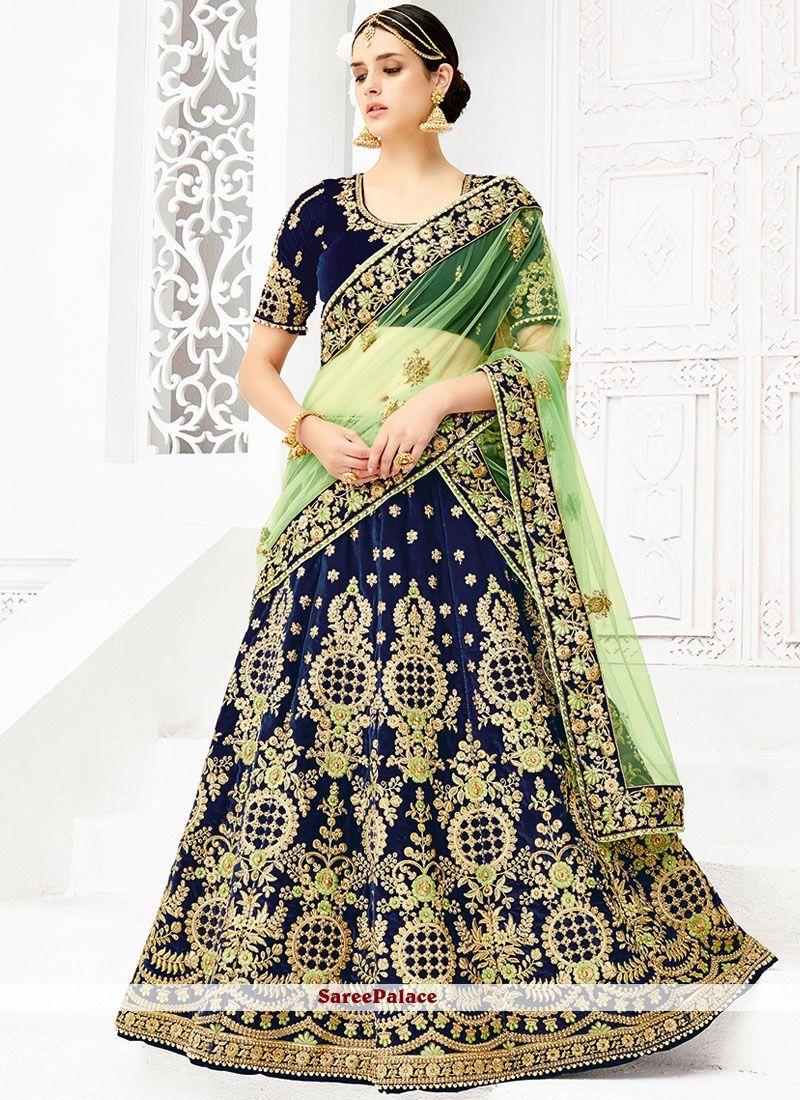 Honourable net green and navy blue stone work lehenga choli bridal