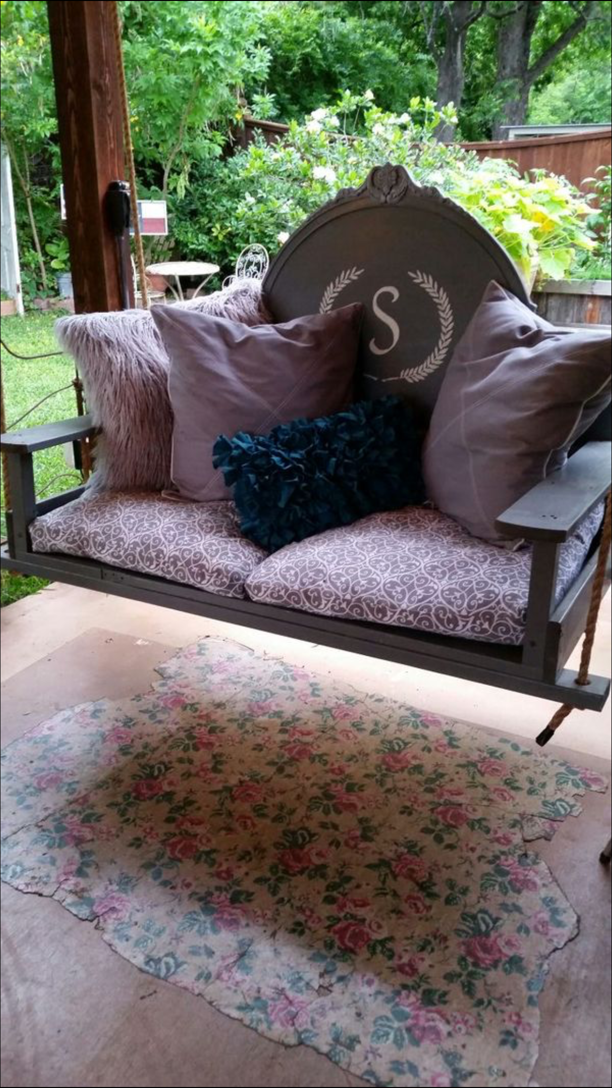 Porch swing made from a vintage headboard and a 5-panel door for the seat ~ by Gina & Eddie, San Antonio TX