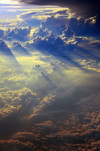 This capture was taken during my flight from China back to Canada. It was so breathtaking that it felt like we were flying past heaven. I'm afraid this photo does not even do it justice.