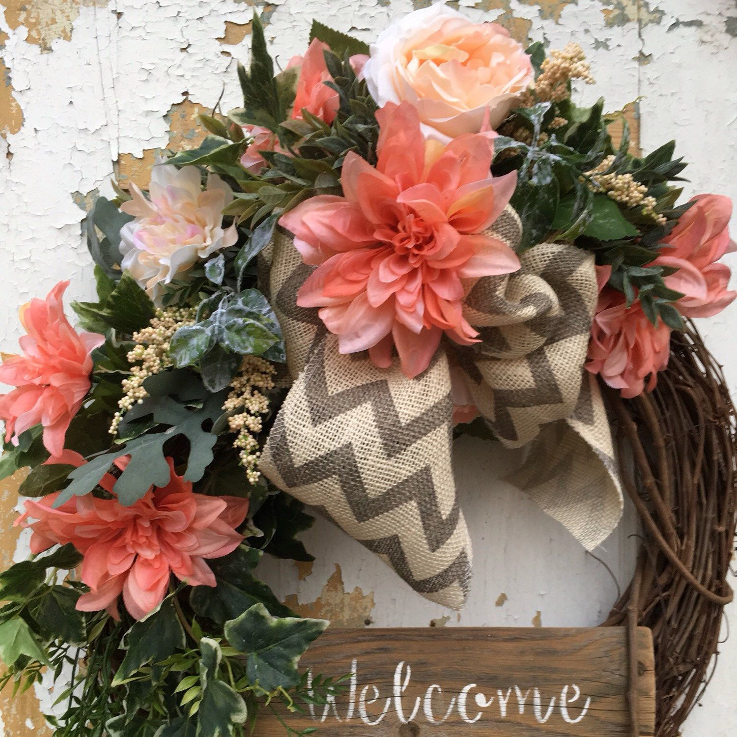 A welcoming Spring wreath with the prettiest salmon colored flowers ...