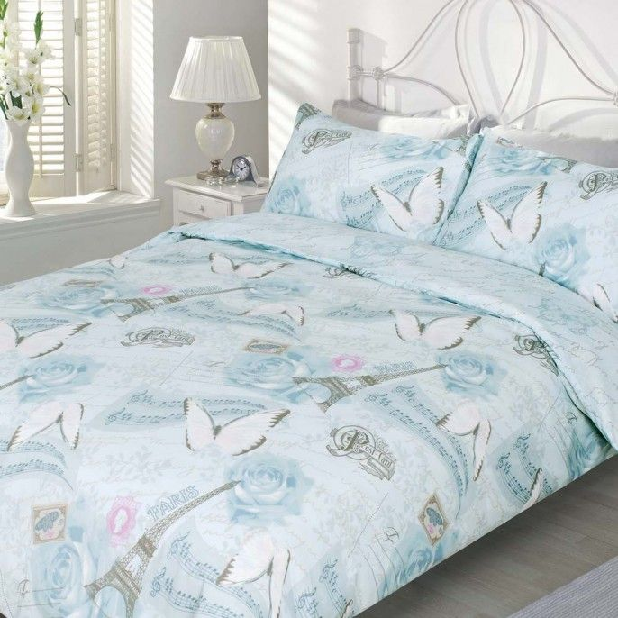 The paris butterfly duvet set comes in a cool water blue with musical notes butterflies and the eiffel tower scattered throughout the print