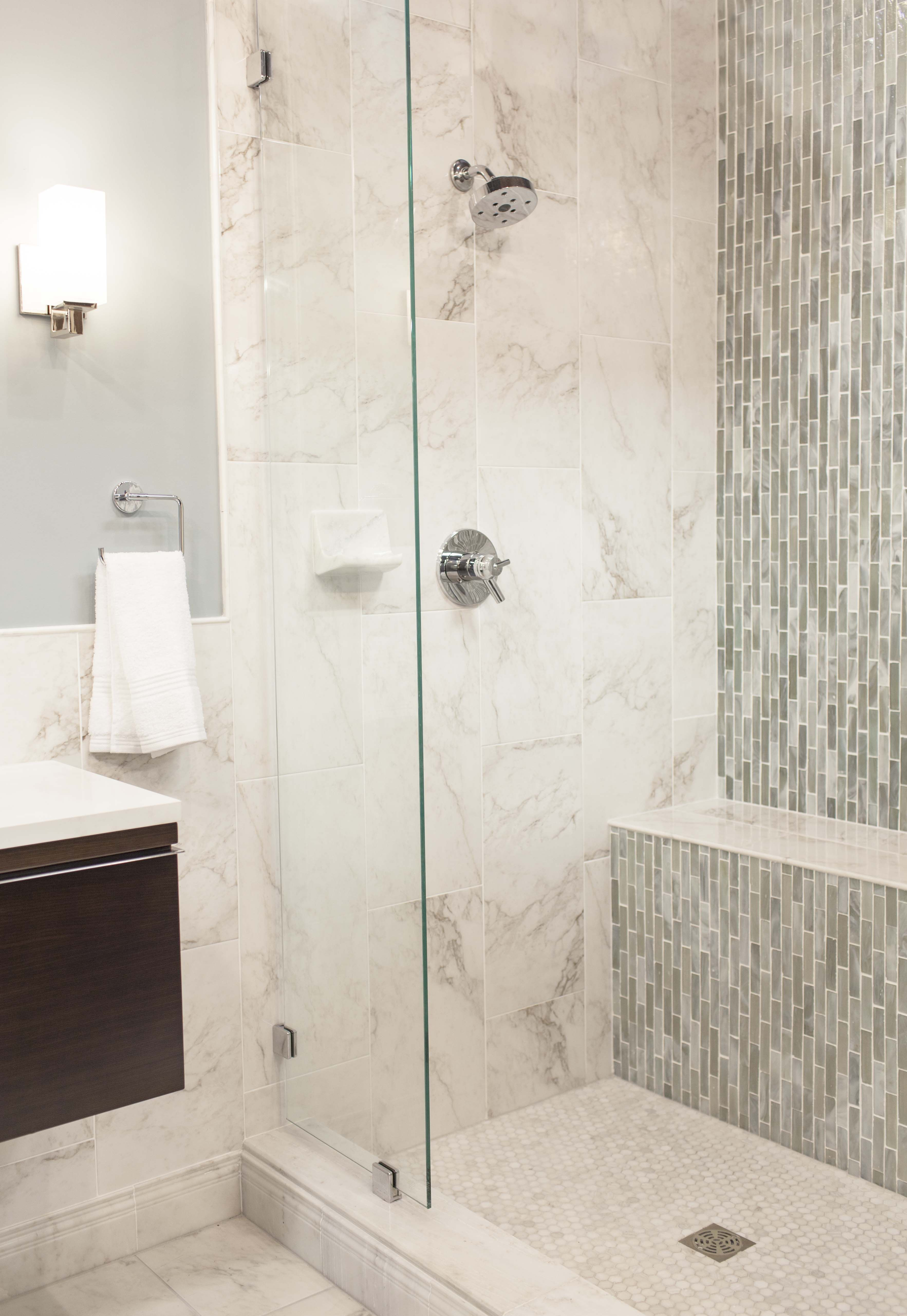Cool bluegreen glass mosaic accents this contemporary shower
