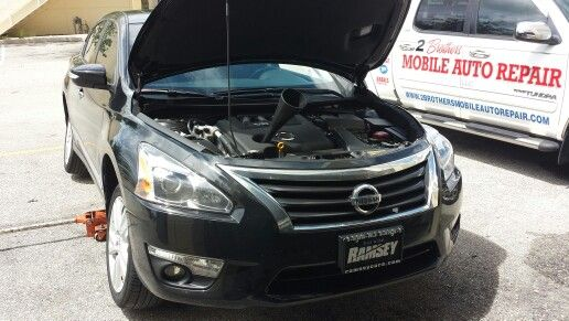 2014 Nissan Altima: Oil Change And Tire Rotation... At Work