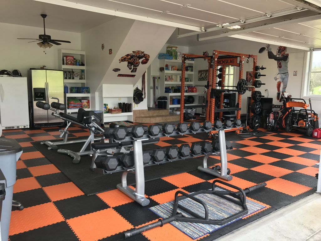 American design garage gym with colourful flooring and