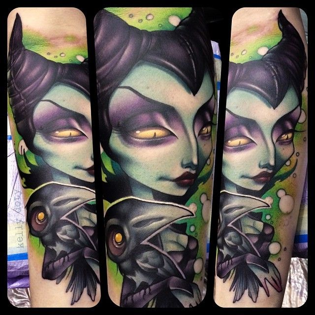 Old cartoon like colored evil witch tattoo on forearm with little crow