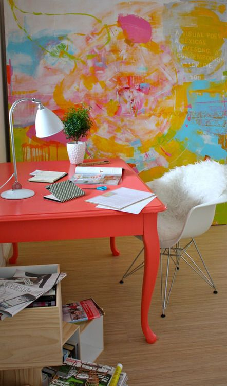 Apartment Therapy find: pretty office space with bright red desk and artwork.