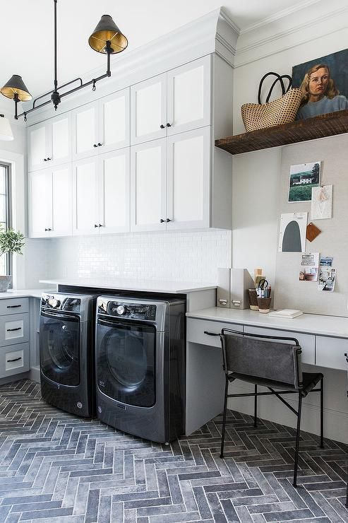 Stacked laundry room cabinets finished in white and gray bring a twotoned design styled with a home office extension