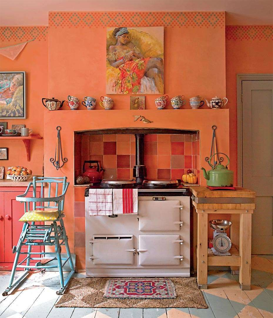 27 Cheerful Orange Kitchen Decor Ideas: The Kitchen Is Painted In
