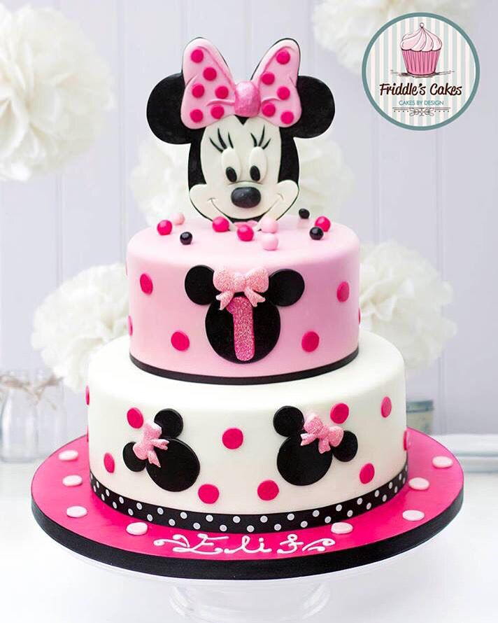 A very pretty tiered mini mouse themed birthday cake #mickeymousebirthdaypartyideas1st