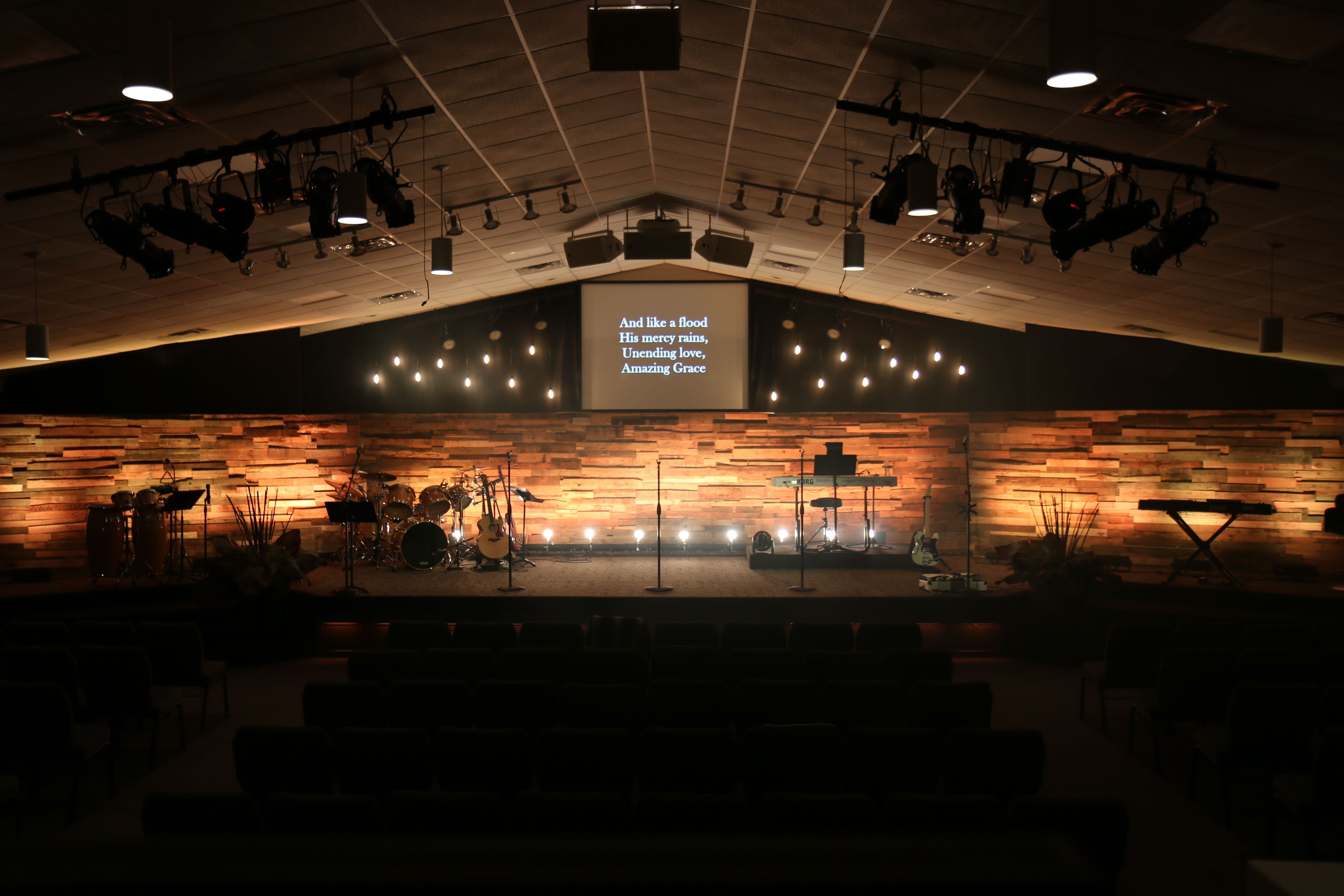 church lighting ideas. pallet wood wall lighting too strong church ideas