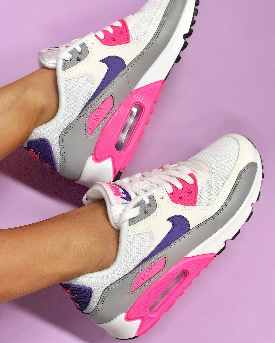 5dbae613b5496 We take a look at this classic Nike Air Max 90 women's shoe in a winning  colour combination of white, purple, grey and pink.