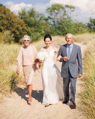 "See the ""The Processional"" in our A Rustic Outdoor Wedding in West Olive, Michigan gallery"
