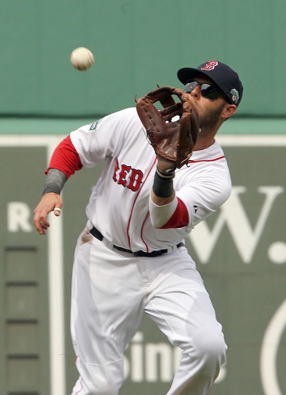 BOSTON, MA - APRIL 15: Dustin Pedroia of the Boston Red Sox grabs a fly against Tampa Bay Rays at Fenway Park April 15, 2012 in Boston, Massachusetts. Both teams wore the number 42 in honor of Jackie Robinson Day. (Photo by Jim Rogash/Getty Images)