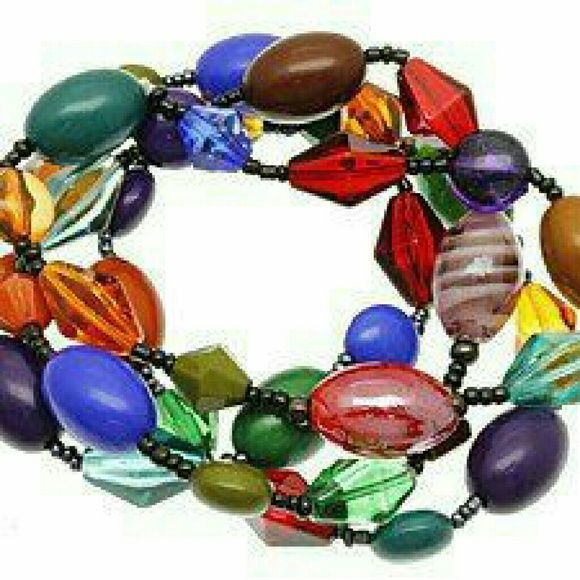 """Colorful glass beaded bracelet set NWT Gorgeous colorful glass beaded bracelet set. Set of four. Stretch fits wrist 6 to 8"""". Designed with strong hold elastic bands that will hold up over time. Brand new with tag. Jill Marie Boutique Jewelry Bracelets"""
