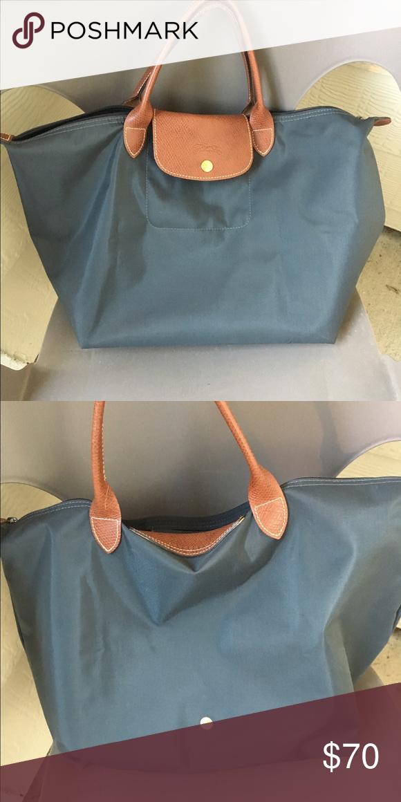 Longchamp bag Large Longchamp bag with short handle. Good condition.  Gunmetal color. Looks like dark grey navy. Longchamp Bags Crossbody Bags 0e00d5a22f