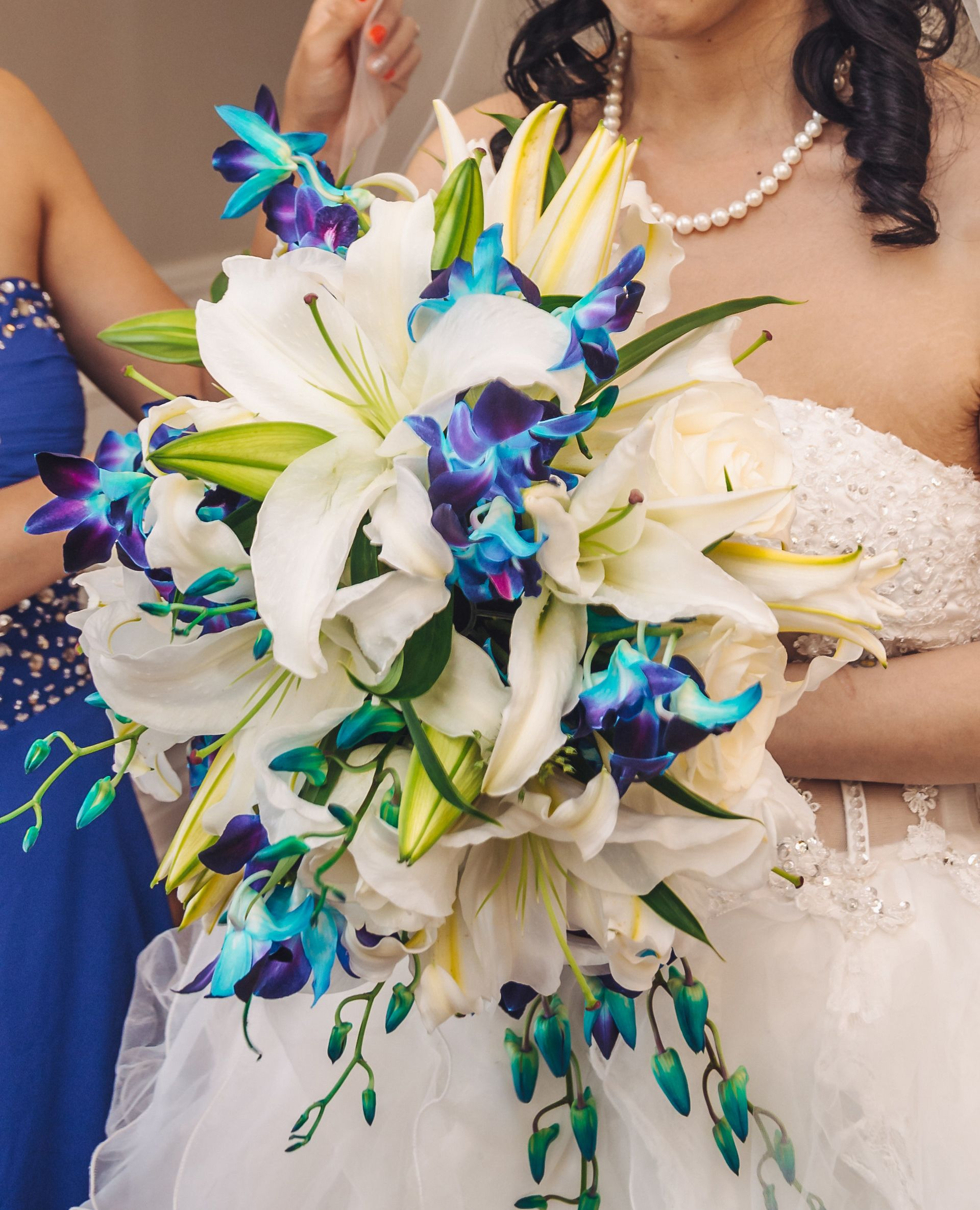 Bridal cascade bouquet holder with blue orchids and white