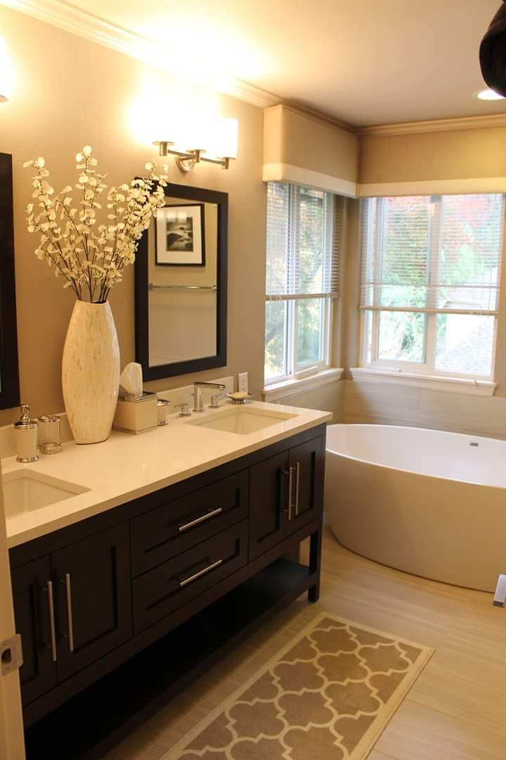 Warm toned #bathroom with furniture-style vanity. Visit Devine ...