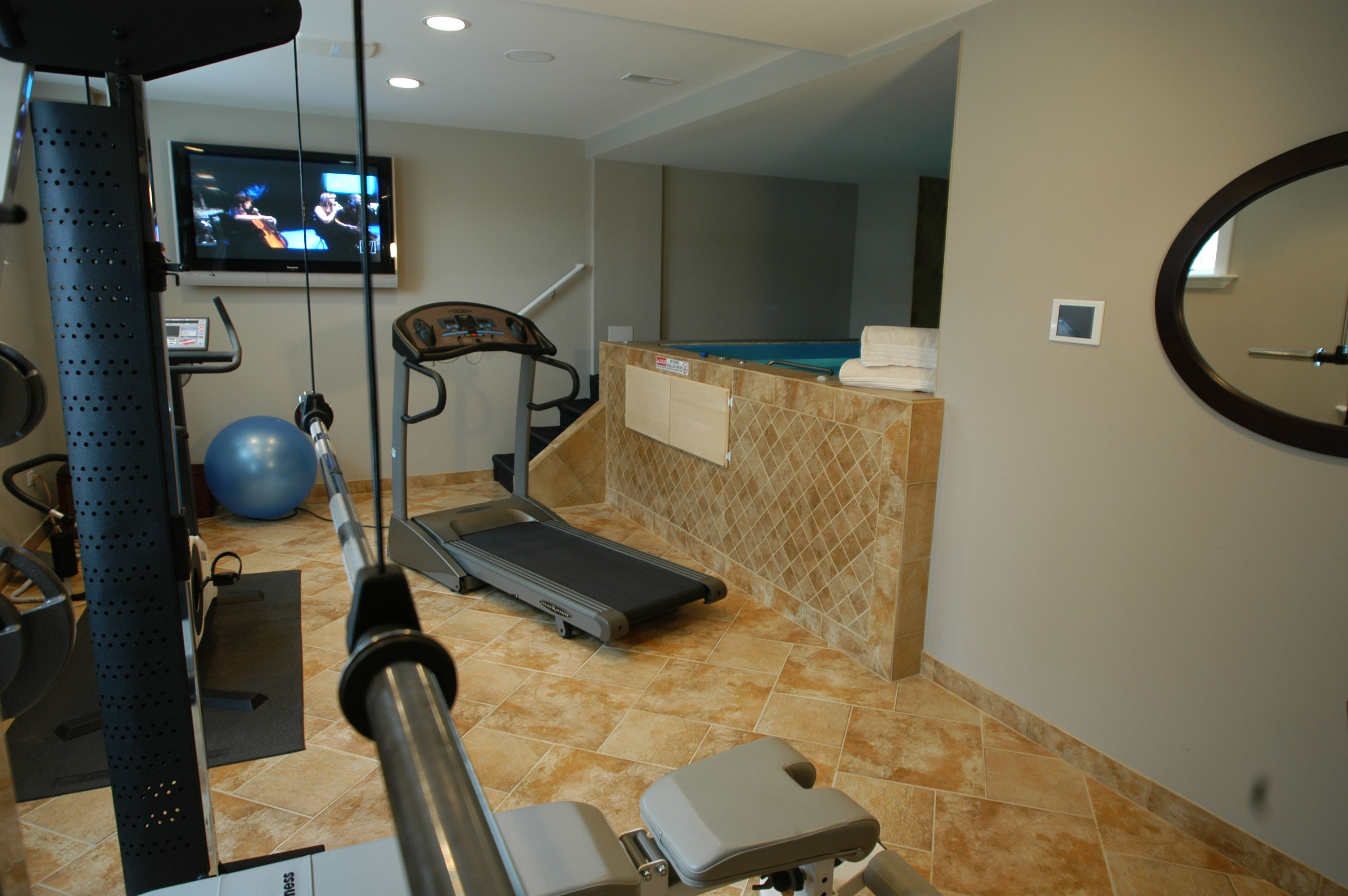 Fitness Room With Full Indoor Hot Tub Located In The Basement Indoor Hot Tub Finishing Basement Basement Design