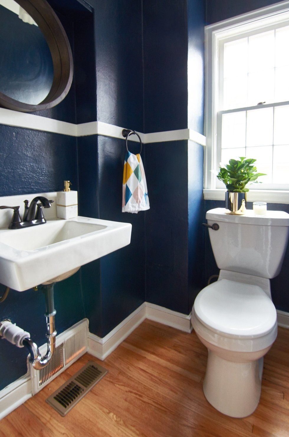 Combine A Small Space With A Bold Sherwin Williams Color And You Ve Got A Gorgeous Getaway Bruno Tiny Bathroom Makeover Bathroom Makeover Blue Bathroom Walls