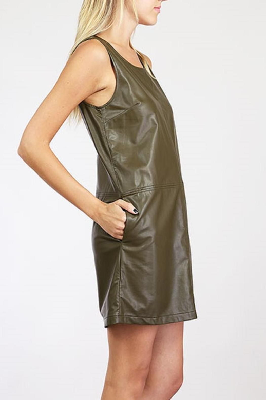 Vegan leather dress with contrast stitching and zipper up the back. Can be worn alone, or can be worn with a shirt layered underneath and a pair of leggings or tights. Fully lined.   Vegan Leather Dress by Amy's Allie . Clothing - Dresses - Casual Ohio