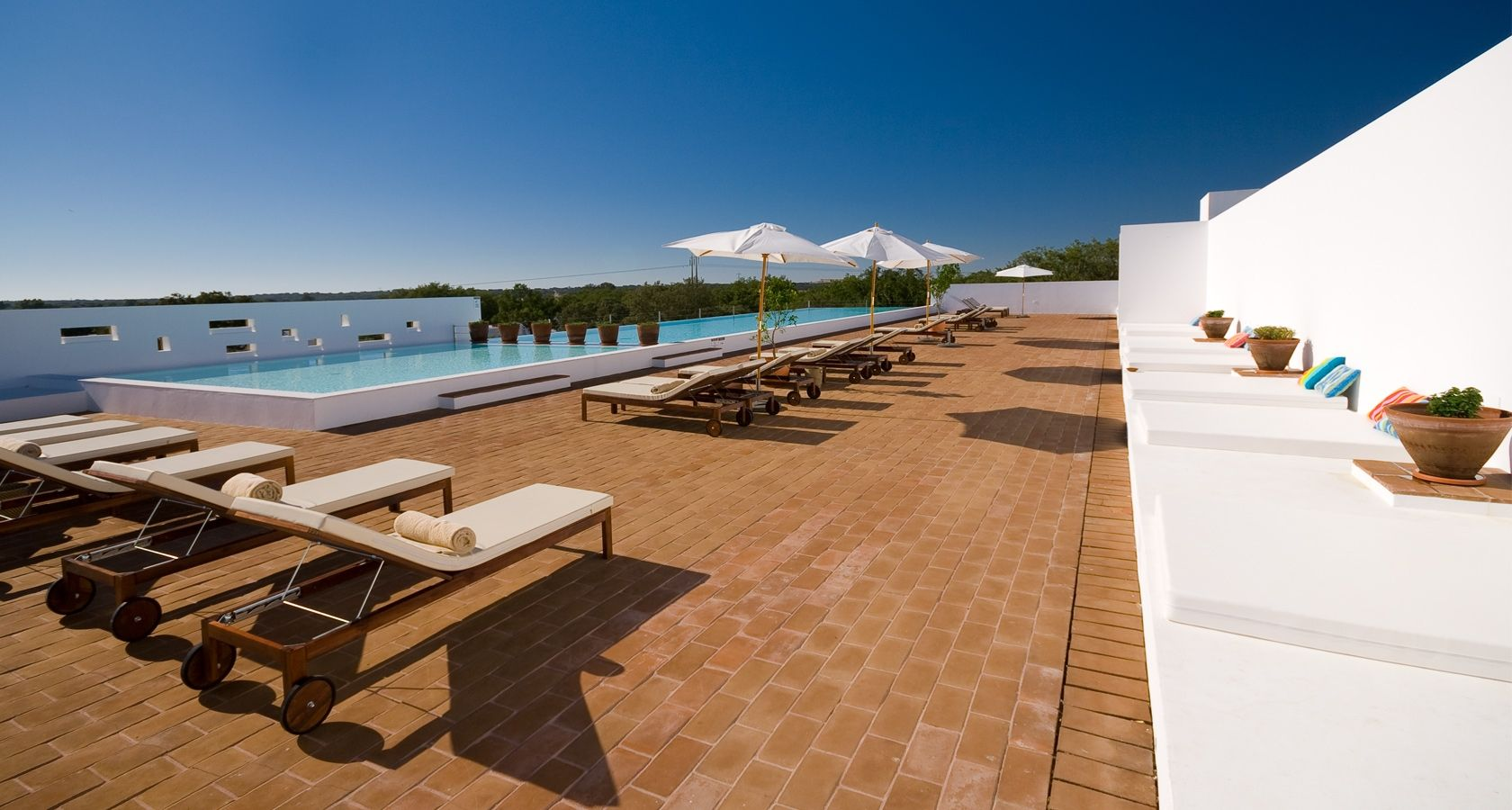 New concept of Hotel in Alentejo plain, Evora, Ecorkhotel & Spa Suites Ecork Hotel  Ecork is a Hotel in Évora, Portugal, with aspa, health club, gym, restaurant, bar, conference rooms, outdoor pool and 56 bungalows.
