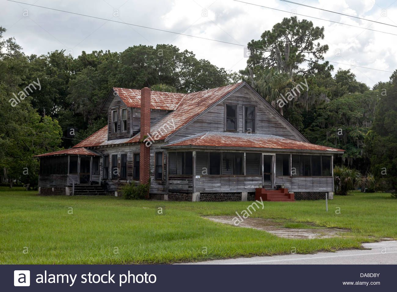 Weathered Old Florida Farmhouse With Red Brick Chimney