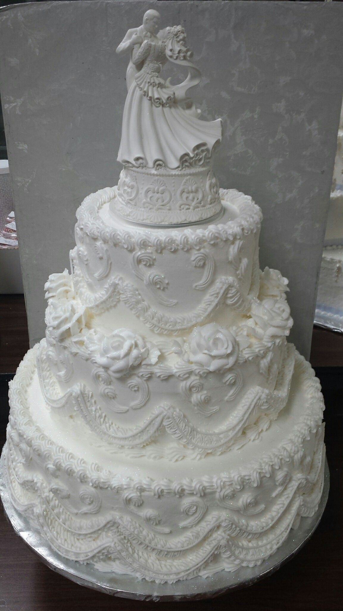 Not so old fashioned wedding cake. Lots of fluff, roses, and string ...