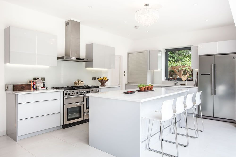 White Kitchen Extensions sleek and modern white kitchen from a single-storey extension